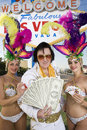 Elvis Presley Impersonator Holding Money And Casino Dancers Holding Playing Cards And Chips Stock Image