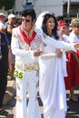 Elvis and priscilla fans dressed as line the route of the parkes festival parade the festival the largest of its kind in the Royalty Free Stock Photo