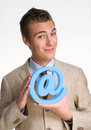 Email man optimistic businessman holding internet globe icon Stock Image