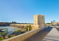 Embankment of guadalquivir river cordoba spain with calahorra tower and the roman bridge Stock Photo