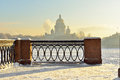 Embankment of the neva river and st isaac s cathedral in strong frost focus on the lattice petersburg russia Royalty Free Stock Photo
