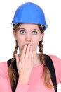 Embarrassed female builder Stock Photography