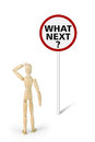 Embarrassed man stands in front of road sign with question What Next? Royalty Free Stock Photo