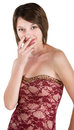 Embarrassed young woman in sleeveless red dress Royalty Free Stock Photography
