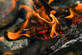 The embers in the fire and the flames Royalty Free Stock Photo