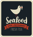 Emblem seafood with seagull with fish in its beak