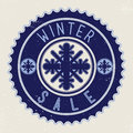 Emblem winter sale with snowflakes on blue retro sticker Royalty Free Stock Photo