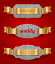Emblems of quality with golden ribbons Stock Images