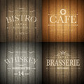 Emblems on wood texture bistro cafe brasserie and whiskey emblem templates wooden background vector illustration Stock Images