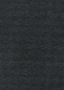 Embossed black paper texture background wallpaper Stock Image