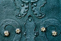 Embossed metallic green-blue background with baroque details and with buttons metal gold  flowers Royalty Free Stock Photo
