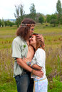 Embrace hippie couple in love on the meadow Royalty Free Stock Image