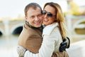 In embrace portrait of happy urban couple looking at camera outdoors Stock Images