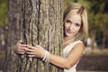 Embracing a tree Royalty Free Stock Photo