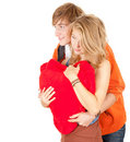 Embracing young couple with red heart Royalty Free Stock Images