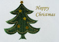 Embroidered christmas tree background glittery wording machine on fabric Stock Image