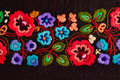 Embroidered flowers Stock Photos