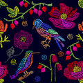 Embroidered flowers and birds on black background.