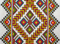 Embroidered good by cross-stitch pattern Stock Images