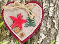 Embroidered heart on tree bark Royalty Free Stock Photo