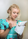 The embroideress young blonde embroiders needle Royalty Free Stock Images