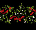 Embroidery christmas seamless landscape pattern with mistletoe.