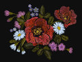 Embroidery colorful floral pattern with poppy and daisy flowers. Vector traditional folk fashion ornament on black background. Royalty Free Stock Photo
