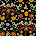 Embroidery ethnic seamless pattern with colorful flowers.