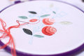 Embroidery with floral motif framed in a hoop. Work in process.
