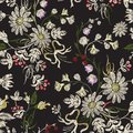 Embroidery floral seamless pattern with chamomiles and bows.