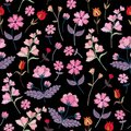 Embroidery seamless pattern with different wild flowers. Vector floral ornament on black background. Satin stitch