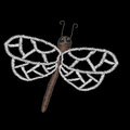 Embroidery stitches imitation dragon fly isolated on the black