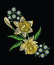 Embroidery stitches with yellow narcissus daffodil, chamomile an