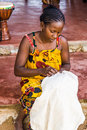 Embroidery tablecloths malagasy woman of nosy be madagascar at work nosy komba on apr Stock Photography