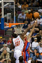 Emeka okafor tries to block tayshaun prince of the charlotte bobcats a shot by during a game against the detroit pistons at the Royalty Free Stock Photography