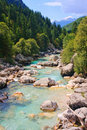 Emerald coloured alpine river Stock Image