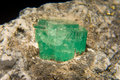 Emerald giant gemstone quality stuck in granite Stock Images