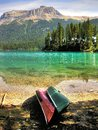 Emerald paradise two canoes ready to hit the crystal clear lake in the vast beautiful landscape of yoho national park british Stock Photography