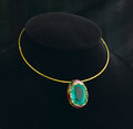 Emerald pendant and golden necklace Royalty Free Stock Photos
