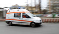 Emergency ambulance speeding on city street Royalty Free Stock Photography