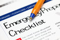 Emergency checklist and ballpoint pen close up Stock Photo
