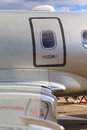 Emergency door fuselage wing and the and in private jet against the blue sky Stock Images