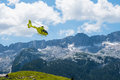 Emergency helicopter hovering over the mountains Royalty Free Stock Photo