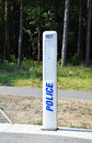 Emergency police caller in the park woods Royalty Free Stock Photography