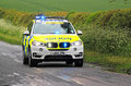 Emergency police car with blue lights flashing a in the united kingdom travelling very fast the Stock Image