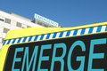 Emergency sign on hospital and ambulance Royalty Free Stock Photo