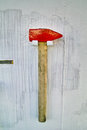 Emergency sledgehammer hammer is mounted on a badly painted ship s bulkhead Royalty Free Stock Images