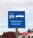 Emergency vehicles traffic sign with ambulance and fire truck on a blue background Stock Photos