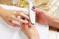Emery polish sandpaper woman nails Salon Royalty Free Stock Photo