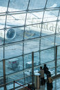 Emirates a seen throw airport windows airbus on dubai international Royalty Free Stock Image